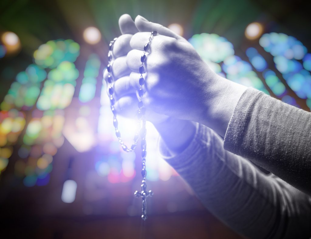 closeup image of hands and rosary